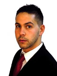 Luke  Nicolaou, estate agent